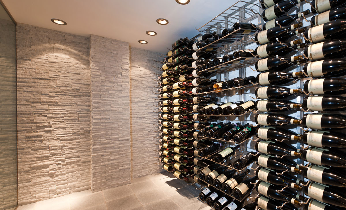 <h2>WINE CELLAR</h2><p>462 bottles conditioned, custom wine racks, honed marble floor, stack stone walls & floor to ceiling ½ thick glass enclosure.</p>